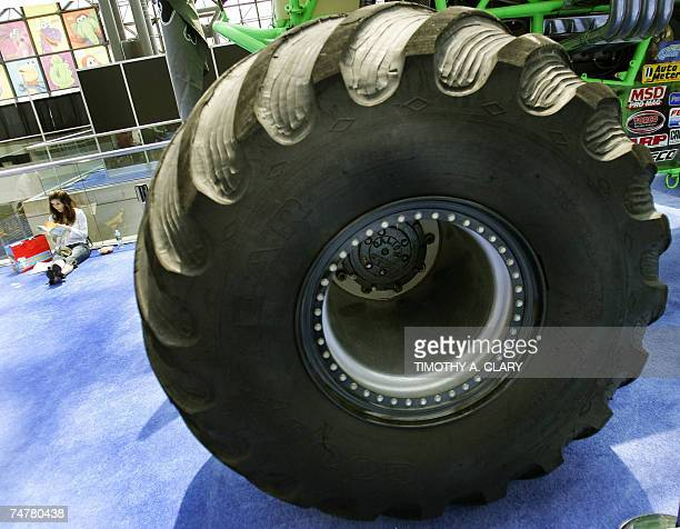 A member of the trade takes a lunch break next to the tire on a Monster Truck during the opening day of the 2007 Licensing International Expo at the...