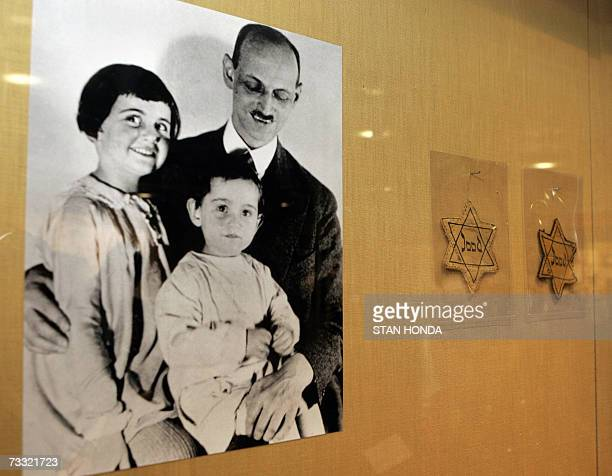 New York, UNITED STATES: A photograph of Otto Frank with his daughters Anne and Margaret with yellow stars worn by Dutch Jews is shown over a display...