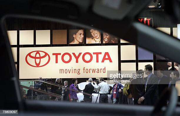 A sign at the Toyota exhibit seen through the driver's side window of a car at the New York International Automobile Show during the press preview...