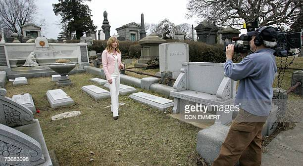 A television news crew does a standup 23 March 2007 in front of magician Harry Houdini's gravesite in the Queens borough of New York Eightyone years...