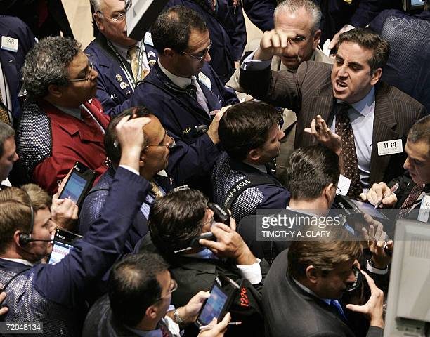 A trader shouts out orders on Tim Hortons stock at the closing bell on the floor of the New York Stock Exchange 29 September 2006 in New York City...