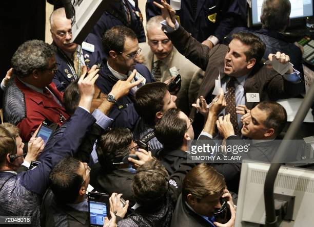 A trader yells out orders on Tim Hortons stock on the floor of the New York Stock Exchange 29 September 2006 in New York City at the closing bell...