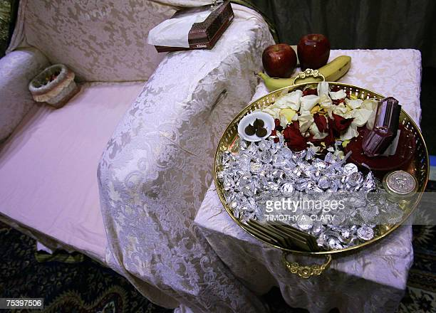 A Tray Of Hershey Kisses Flower Pedals And Fruit Sit Next To The Chair Amma