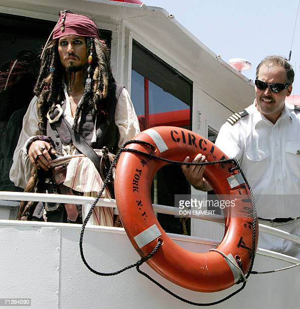 A wax figure of Johnny Depp as Captain Jack Sparrow from Madame Tussauds is offered a floatation device by Captain Corcran of Circle Line X as she...