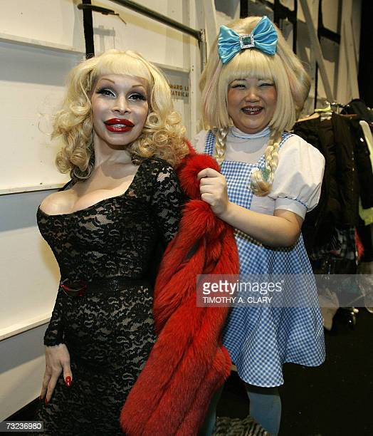 Amanda Lepore New York City's transexual fashion icon since the early 1990s is helped with her coat by a guest backstage before the Heatherette Fall...