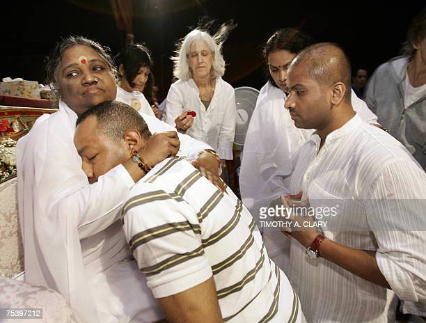 Amma 'the Hugging Saint' whose real name is Mata Amritanandamyahi the spiritual guru from India gives a hug or Darshan as it is called to a follower...