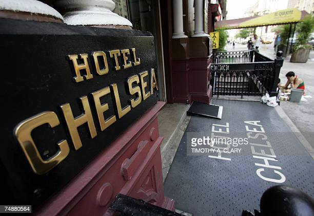 An artist paints on the sidewalk in front of the Hotel Chelsea in New York City 25 June 2007 Chelsea Hotel manager Stanley Bard who has been a...