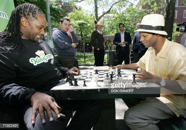 British boxer Lennox Lewis plays chess against Poe ...