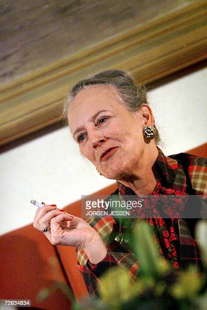 New York, UNITED STATES: Danish Queen Margrethe holds a cigaret in this November 1999 file photo taken in New York. The royal Danish Court announced...