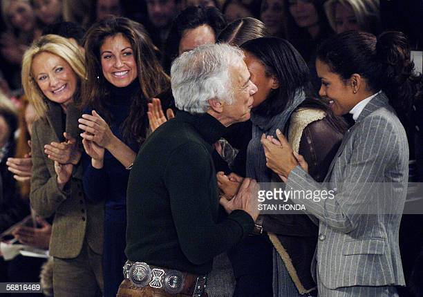 New York, UNITED STATES: Designer Ralph Lauren gets a hug after his Fall 2006 Fashion show 10 February in New York as actress Halle Berry , Lauren's...