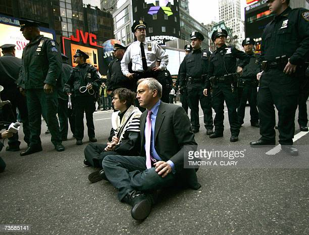 Executive Director of the National Gay and Lesbian Task Force Matt Foreman and Rabbi Sharon Kleinbaum sit down in the middle of Broadway in Times...