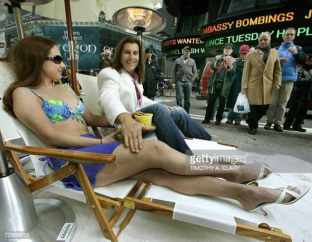 Fabio the 'King of Romance' and cover model for hundreds of romance novels poses with model Jennifer Lorae on lounge chairs on a makeshift island in...