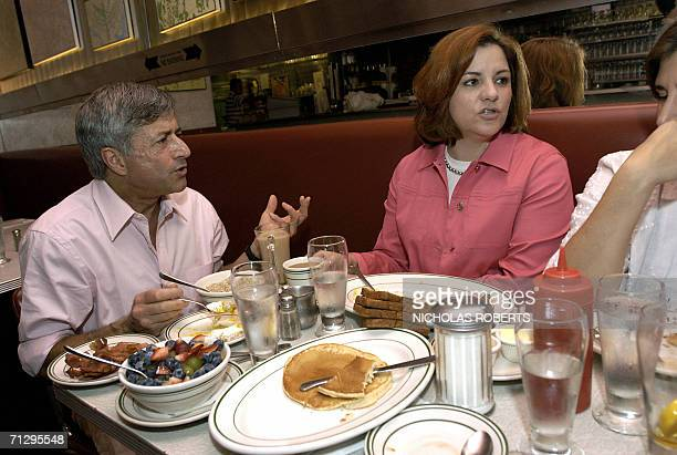 New York, UNITED STATES: Florent Morellet, City Council Speaker Christine C. Quinn and Kim Catullo, Quinn's partner, chat over breakfast at...