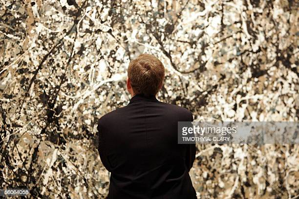 French Culture Minister Renaud Donnedieu de Vabres looks at a painting by Jackson Pollock at the Museum of Modern Art in New York 03 November 2005...