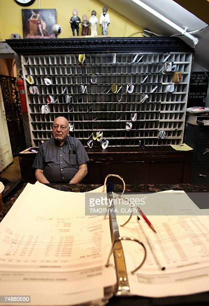 Front desk manager Jerry Weinstein sits in the the lobby of the Hotel Chelsea in New York City 25 June 2007 Chelsea Hotel manager Stanley Bard who...