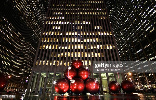 New York, UNITED STATES: Giant Christmas tree ornaments sit in the plaza of a high-rise building on 6th Avenue in New York 06 December 2006....