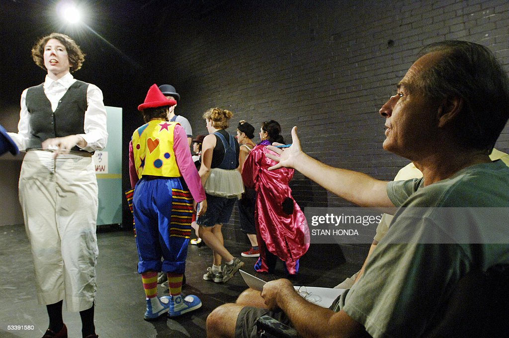 Instructor Dick Monday (R) gives orders to students just before a performance of the New York Goofs Ultimate Clown School, 14 August, 2005, in New York. The two week session offers an intensive course of study in the art of clowning and is one of the few clown schools in the U.S. AFP PHOTO/Stan HONDA
