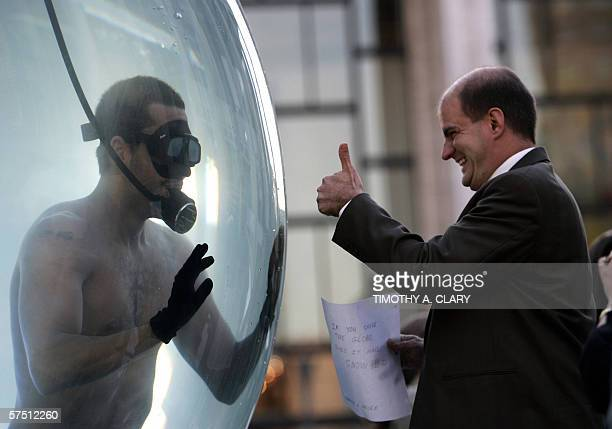 International performance artist and magician David Blaine talks to fans from his glass sphere filled with water 01 May 2006 at Lincoln Center in New...