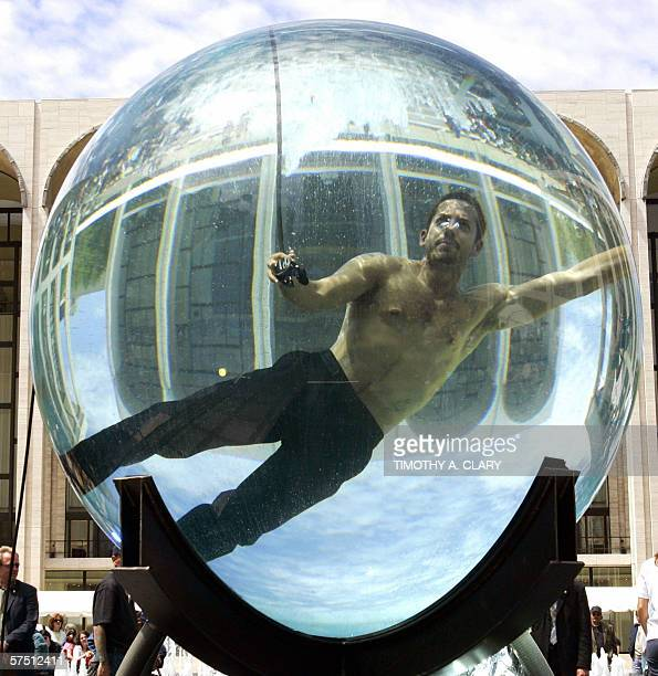 International performance artist and magician David Blaine floats inside a glass sphere filled with water 01 May 2006 at Lincoln Center in New York...