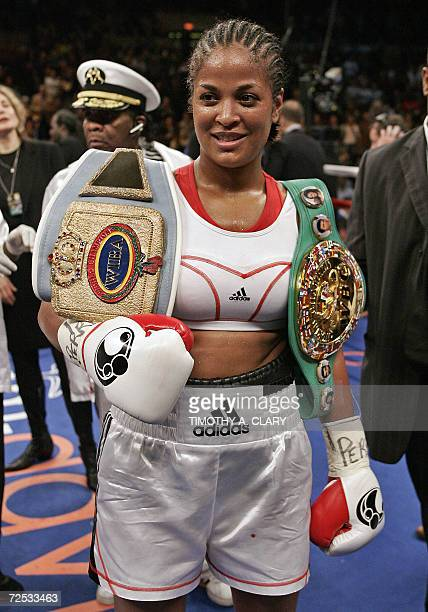Laila Ali of the US holds her belts after winning her ten round WBC Super Middleweight Championship fight against Shelley Burton also of the US 11...