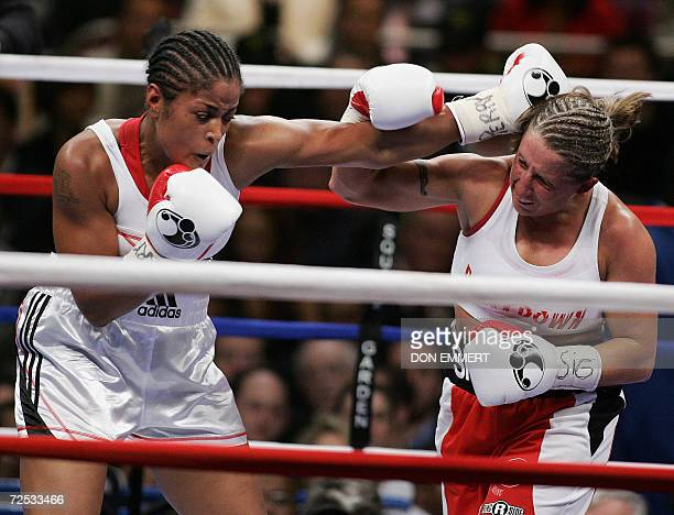 Laila Ali of the US lands a punch on Shelley Burton of the US during their WBC Super Middleweight Championship fight 11 November 2006 at Madison...