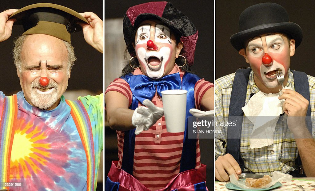Lew Robinson of Redding, CT (L), Jenny Melo of Peru (C) and Christopher Lueck of Brooklyn, NY (R) during a performance of the New York Goofs Ultimate Clown School before family and friends, 14 August, 2005, in New York. The two week session offers an intensive course of study in the art of clowning and is one of the few clown schools in the U.S. AFP PHOTO/Stan HONDA