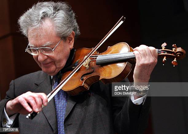 Lewis Kaplan instructor from The Julliard School plays a 1729 Stradivari known as the 'Solomon ExLambert' 27 March 2007 at Christie's in New York The...