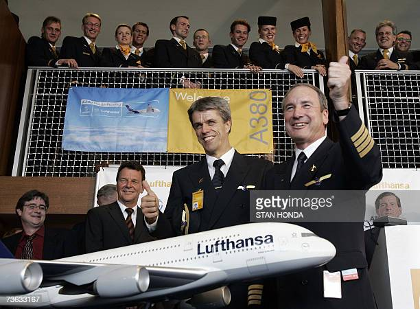 Lufthansa pilot Juergen Raps and copilot Raimund Muller and crew pose with a model of the Airbus A380 they landed at John F Kennedy Airport in New...