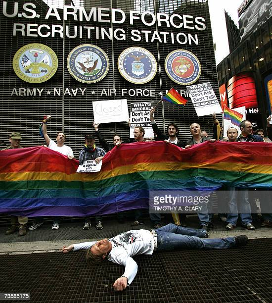 Members of ACT UP hold out a banner as they demonstrate in New York 15 March 2007 The group protested at the Times Square Military recruitment center...