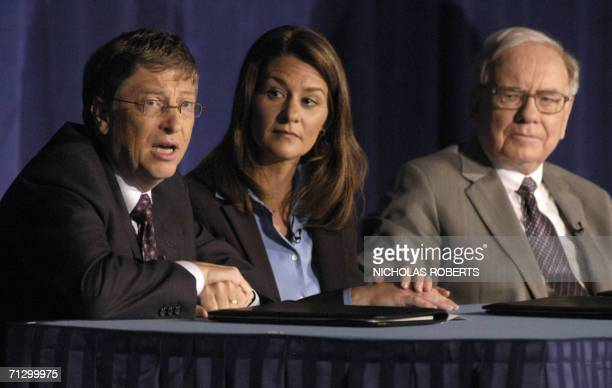 New York, UNITED STATES: Microsoft co-founder and chairman Bill Gates answers questions during a news conference 26 June 2006 in New York with wife...
