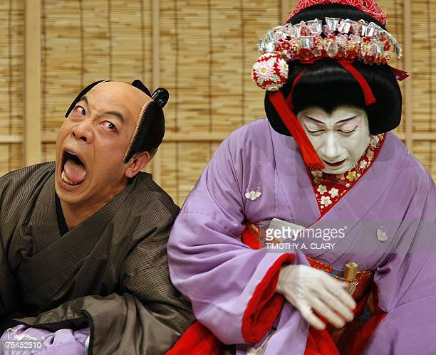 Nakamura Senjaku in the role of Okumi and Kataoka Kamezo in the role of Shohachi perform during the dress rehersal for 'Hokaibo' in the Avery Fihser...