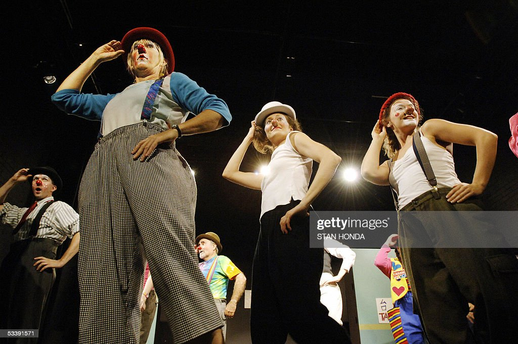 Nancy Barber (L), Tara Inden (C) and Olivia Lehrman (R) along with other students practice a group dance just before a performance of the New York Goofs Ultimate Clown School 14 August 2005 in New York. The two-week session offers an intensive course of study in the art of clowning and is one of the few clown schools in the US. AFP PHOTO/Stan HONDA