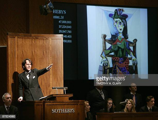 Pablo Picasso's Dora Maar au chat is auctioned by Tobias Meyer at Sotheby's New York during the Impressionist and Modern Art Sale 03 May 2006 The...