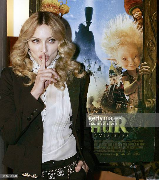 "New York, UNITED STATES: Pop star Madonna arrives at the Tribeca Cinema to host a special screening of her new animated film ""Arthur and The..."