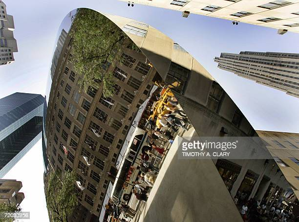 Rockefeller Center and 5th Ave are reflected in a threestory polished stainless steel artwork called 'Sky Mirror' by Anish Kapoor on display in New...