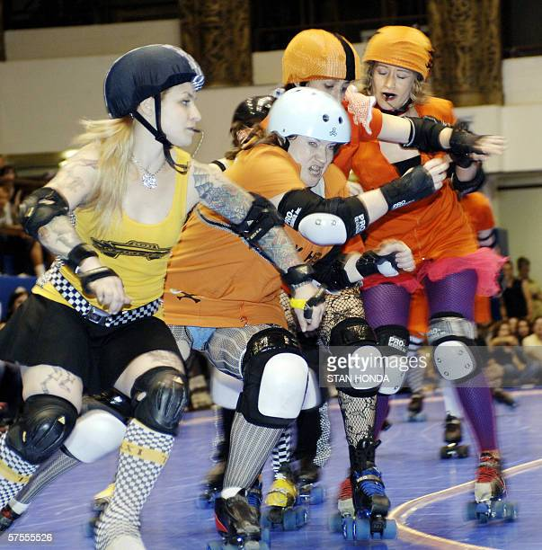 Roller derby skater Maddy nicknamed 'Surly Temple' of the Manhattan Mayhem gets squeezed between teammates Megan Goldman 'Blue Bonnet Plague' Andrea...