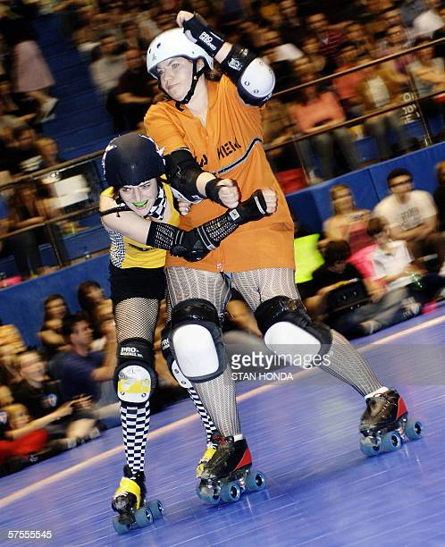 Roller derby skater Zoe Logan nicknamed 'Beatrix Slaughter' of the Bronx Gridlock wrestles with Maddy nicknamed 'Surly Temple' of the Manhattan...