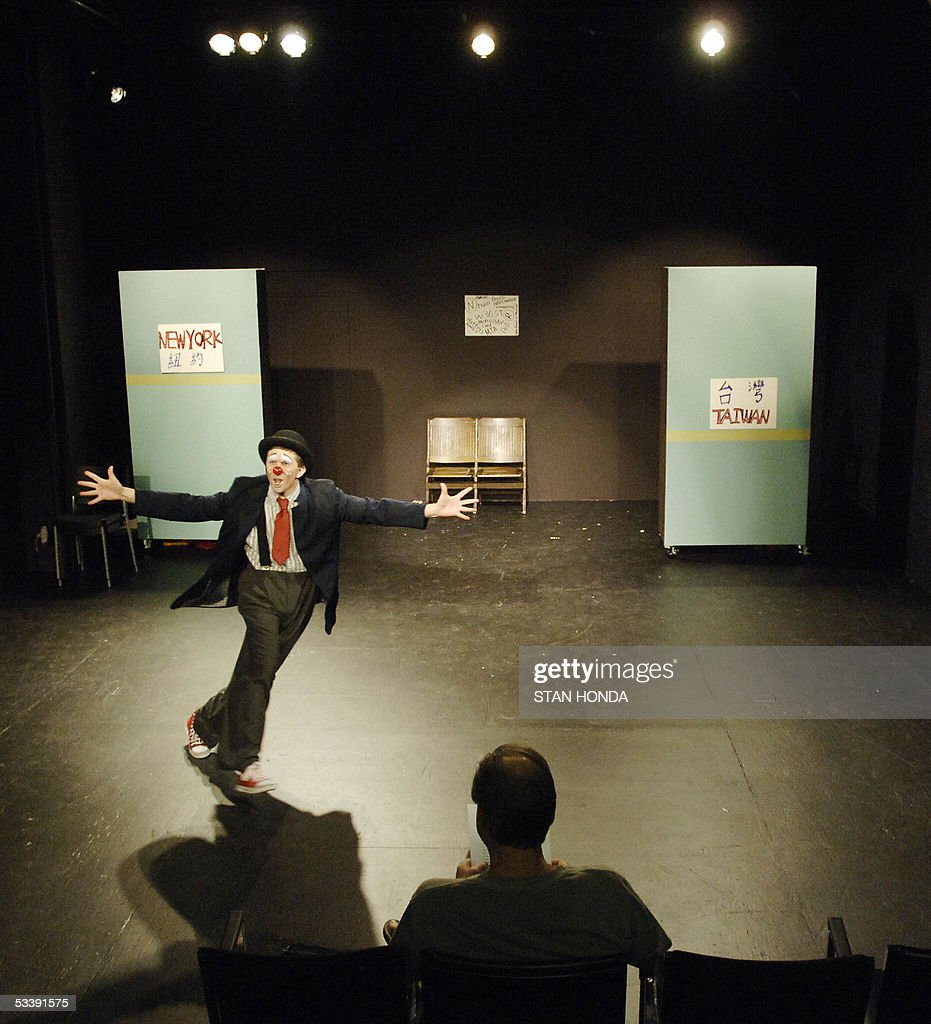 Ryan O'Neil of Chicago practices his routine on an empty stage just before a performance of the New York Goofs Ultimate Clown School, 14 August, 2005, in New York. The two week session offers an intensive course of study in the art of clowning and is one of the few clown schools in the U.S. AFP PHOTO/Stan HONDA