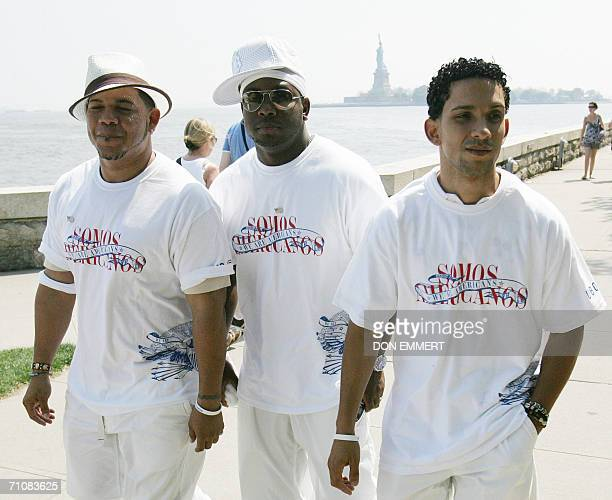 The group Voz A Voz walk on Ellis Island before the Statue of Liberty 30 May 2006 in New York where their controversial Spanish version of the US...