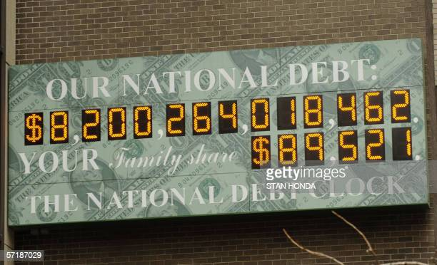 The National Debt Clock at 1133 Avenue of the Americas and 44th Street 26 March in Midtown Manhattan New York shows the total US government debt and...