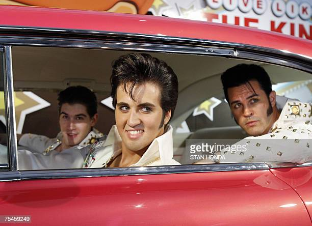 Three Elvis Presley impersonators sit in a custom built pink 1957 Cadillac 17 July 2007 at a promotion in New York for Reese's candy The special...