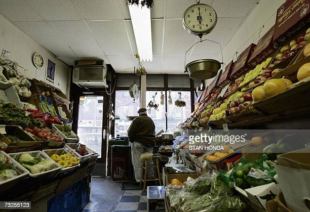 """New York, UNITED STATES: TO GO WITH AFP STORY BY ALFONSO LUNA- EEUU-NY-SOCIETY: Vincent Cincotta looks out onto Court Street from the """"Jim and Andy""""..."""