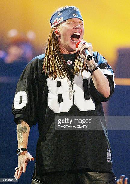 TO GO WITH AFP STORY USAMUSICROCKPEOPLEROSE In 29 August file photo Axl Rose of Guns 'n Roses performs at the MTV Video Music Awards in New York The...