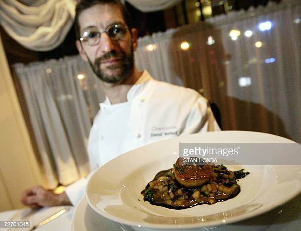 TO GO WITH AFP STORY USDAfoodgastronomyanimals David Waltuck chef at Chanterelle restaurant holds a dish with a piece of foie gras on potato risotto...