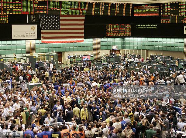 Traders shout orders across the crude oil futures pit of the New York Mercantile Exchange 22 June 2005 as oil prices neared $60 USD per barrel US...