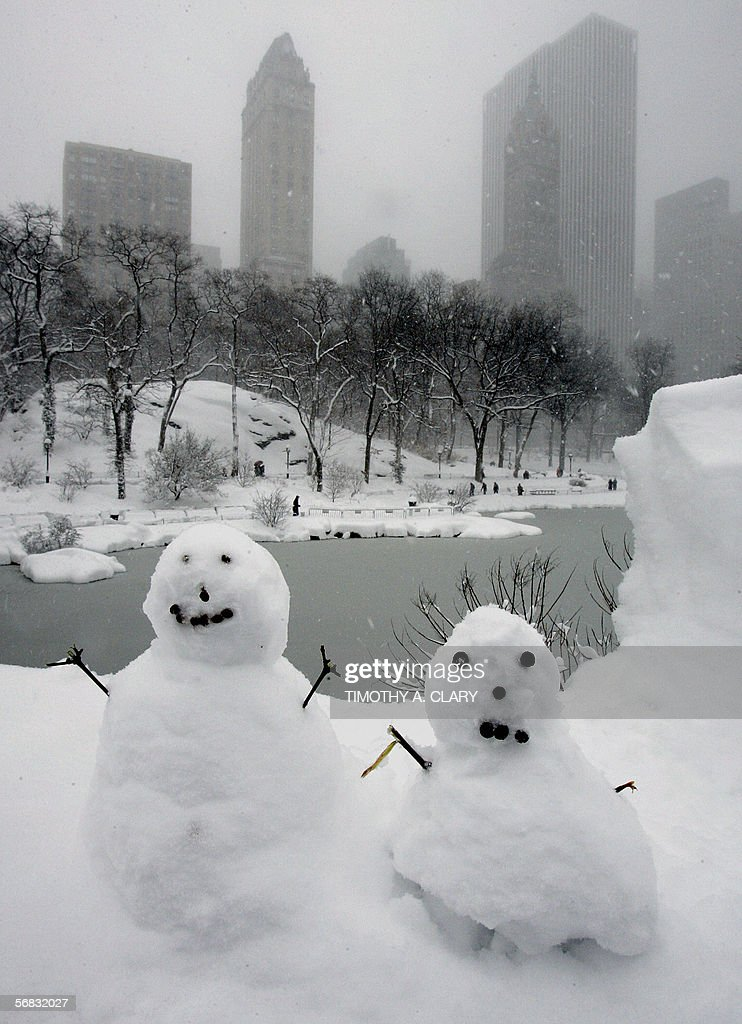 Two miniature snowmen sit in the snow on the Gapstow Bridge in Central Park 12 February 2006 as a major storm slammed the mid-Atlantic and Northeast states dumping nearly two feet (60cm) of snow in Central Park by late morning, the city's second heaviest snowfall on record, surpassed only by the 26.4 inches (67cm) that fell in December 1947. AFP PHOTO/Timothy A. CLARY