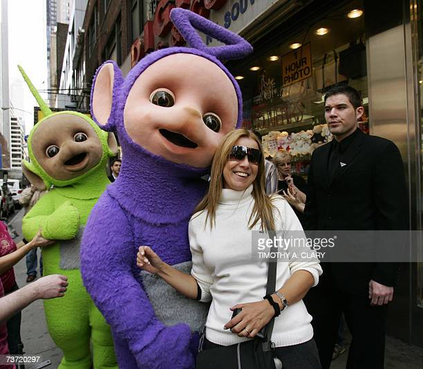 Two of the world famous Teletubbies TinkyWinky and Dipsy wait for the rest of the group as they prepare to cross 7th Avenue in Times Square in New...