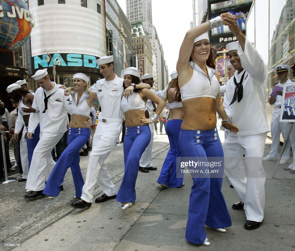 United States Navy sailors from the USS Wasp dance with the New York Knick City Dancers during an event in Times Square 24 May 2007 to kick off Fleet Week in New York.
