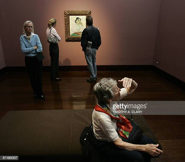 Van Gogh's 'L'Arlesienne Madame Ginoux' is shown to the media during a press preview 28 April 2006 at Christie's New York to promote the evening sale...