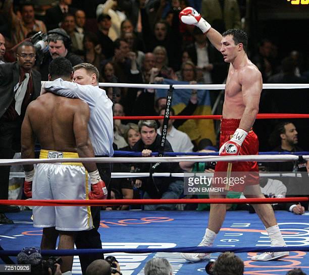New York, UNITED STATES: Wladimir Klitschko of Ukraine celebrates his victory over Calvin Brock of the US during their IBF/IBO Heavyweight...